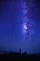 woman stand under milky way watch night sky
