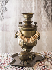 Samovar with bagels, standing on a tray with a sugar bowl