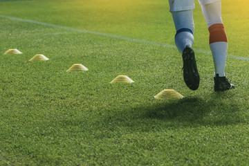 funnels on on soccer field. Soccer player practice before game start