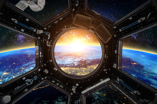 Earth and Spacecraft. Elements of this image furnished by NASA.