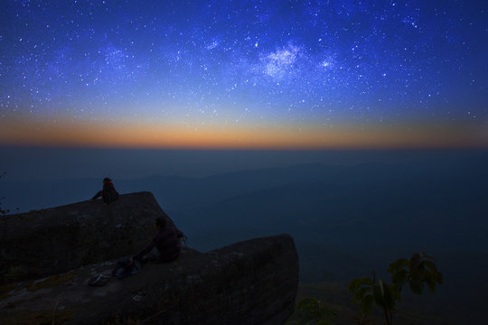 woman sit see the milky way at night