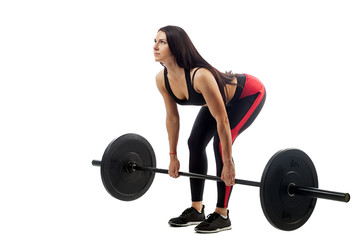 Young athletic sporty woman fitness model doing deadlift with barbell on white isolated background, position at bottom