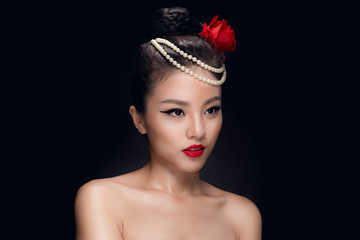 Fashion studio shot of beautiful young asian woman with retro hairstyle