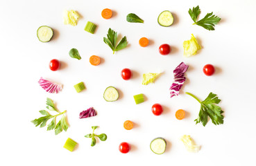 Eating pattern with raw ingredients of salad, lettuce leaves, cucumbers, red tomatoes, carrots, celery on white background