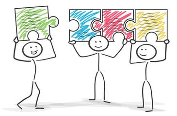 Strichmännchen Puzzle Teamwork Zusammenhalt bunt
