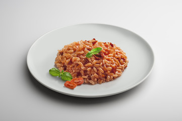 Risotto dish with dried tomatoes and basil