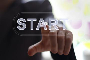 Businessman pressing button start modern technology panel