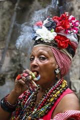 Woman smoking cigar, old Havana, Cuba.