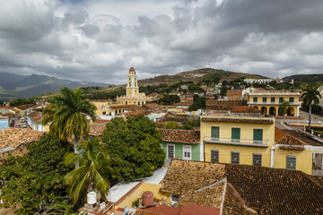 An elevated view of the terracotta roofs and the bell tower of the Museo Nacional de la Lucha (formerly Iglesia y Convento de San Francisco). Trinidad, Sancti Sp'ritus province, Cuba.