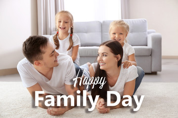 Happy parents with daughters lying on floor