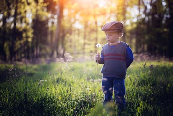Young boy playing outdoor in spring scenery