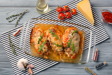 Delicious chicken parmesan meal with cheese and sauce in baking dish