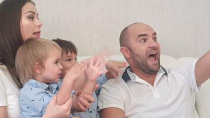 Smiling family taking selfie in the living room