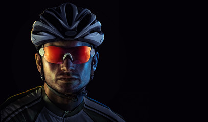 Cyclist. Dramatic close-up portrait Wall mural