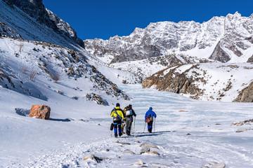 A group of tourists goes to climb Munku-Sardyk mount