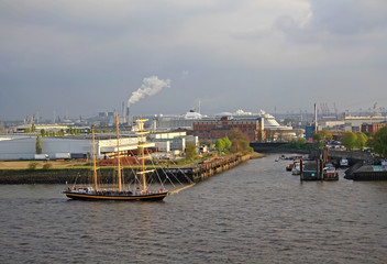 Hamburg port view with one sailboat and cruise liner