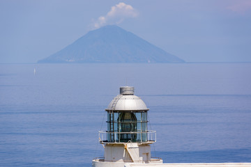 Capo Faro lighthouse in Eolian island Salina in Sicily Italy in summer with Stromboli island in background