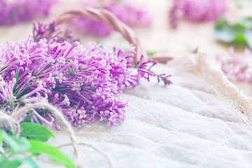 Fresh splendid lilac flowers on tray, soft focus background