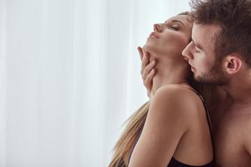 Man touching woman's neck