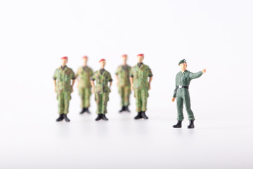 Miniature model team soldier model standing together, people war concept,  isolatrd on white background.