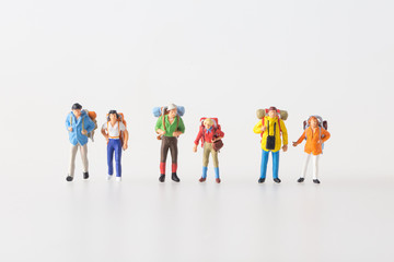 Miniature model team traveller model standing together, people travel in concept,  isolatrd on white background.