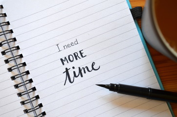 I NEED MORE TIME hand lettered in notebook