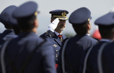 Spain's King Felipe salutes troops while attending a ceremony at an airforce academy in La Virgen del Camino, near Leon