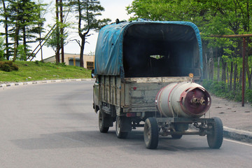 Truck hauls propane barrel on a trailer