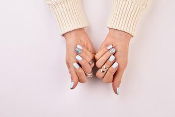 Wall Mural - Silver rings on women's fingers.