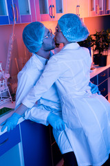 Scientists having office romance at laboratory during work