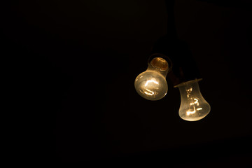 Two light bulb in the dark