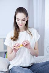 Woman taking contraceptive pill
