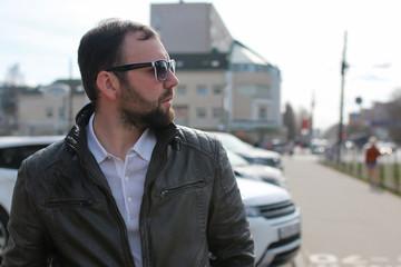 beard man in jacket and sunglasses street
