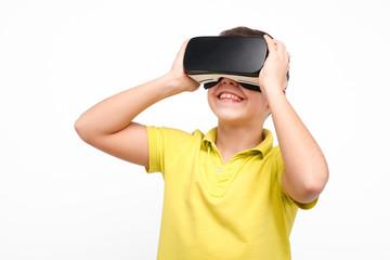 Smiling boy enjoying VR goggles