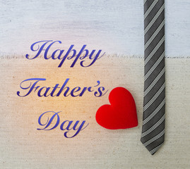 Happy Father's day card concept, Red heart with black necktie design on canvas background