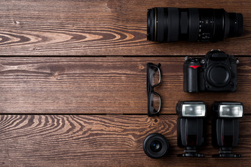 Photography equipment on wooden table