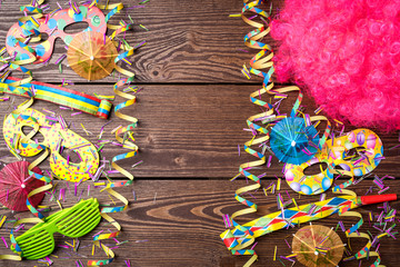 Colorful party background on wooden table