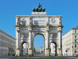 "Siegestor - the triumphal arch in Munich, Germany. It was commissioned by King Ludwig I of Bavaria and completed in 1852. Dedication on the frieze means ""To the Bavarian army""."