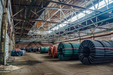 Warehouse of twisted rubber tubing of industrial hoses