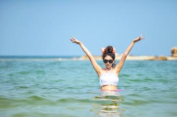 Woman wearing bikini standing in the sea.