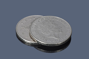 British ten pence coins on the dark background