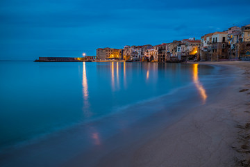 Cefalu, Sicily - Blue hour view of the beautiful Sicilian village of Cefalu with mediterranean sea and traditional italian houses