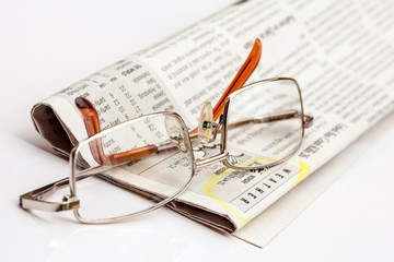Reading glasses on the newspaper