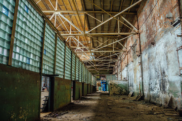 Abandoned ruins of Voronezh factory of radio components, corridor with glass block wall