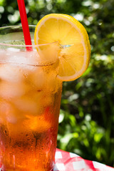 Fourth of July iced tea with lemon summer picnic closeup