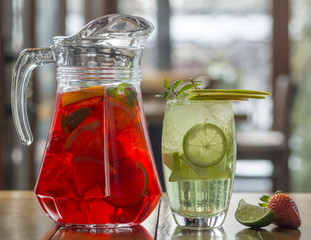 Different types of fresh lemonades. Summer drinks with ice, fresh berries and citrus fruits.