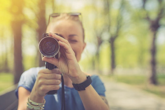 Summer. Young beautiful woman with vintage camera