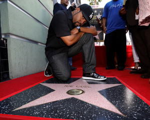 Rapper Ice Cube poses by his star after it was unveiled on the Hollywood Walk of Fame in Los Angeles