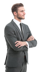 Successful young man in full suit smiling. Looking to the side.
