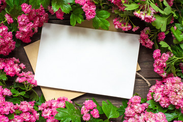 creative branding mock up to display your artworks. blank greeting card with pink flowers